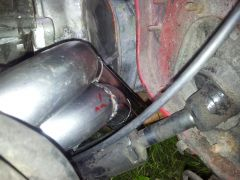 Showing the lack of space with the left exhaust manifold, clutch cover and steering column.