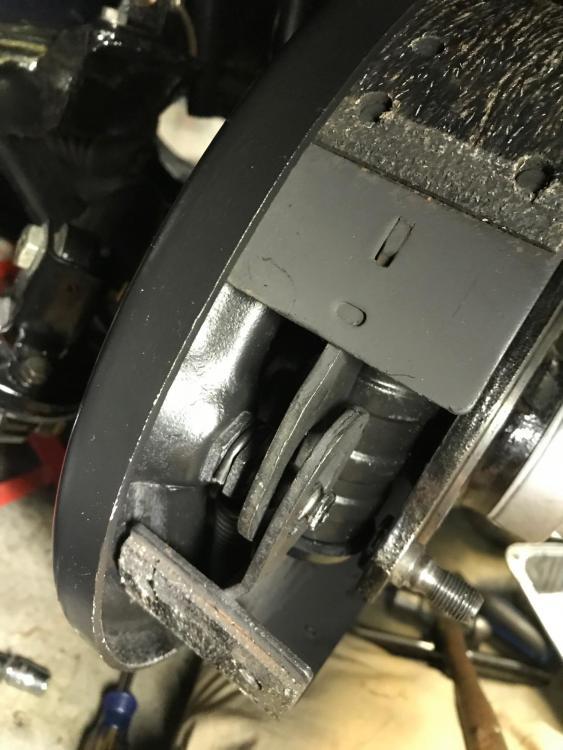 Driver side front brake spring detail.jpg